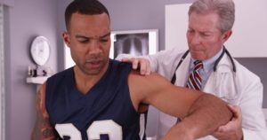 Doctor checking patient in shoulder pain.